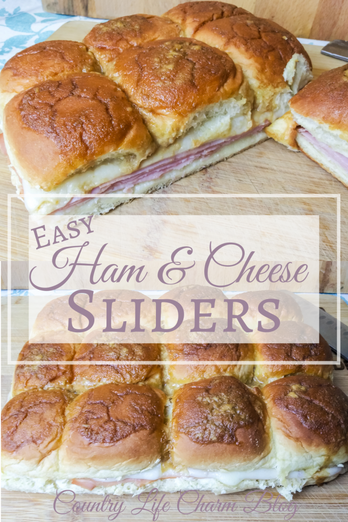 Ham and swiss cheese sliders on a wood cutting board