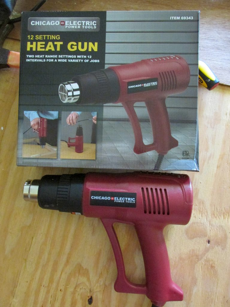 red heat gun used for heating up glue on exposed shiplap