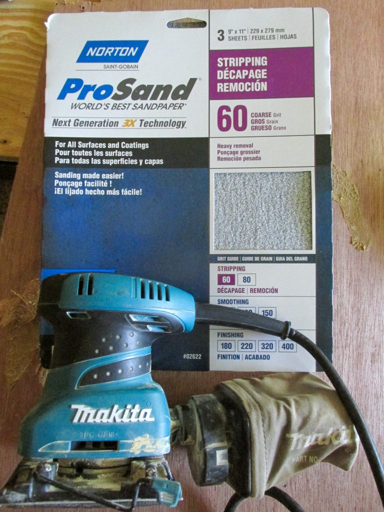 blue sander and sandpaper