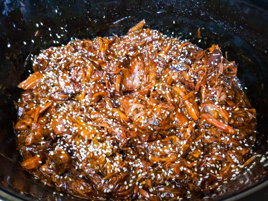 orange beef is ready with sesame seeds sprinkled on top