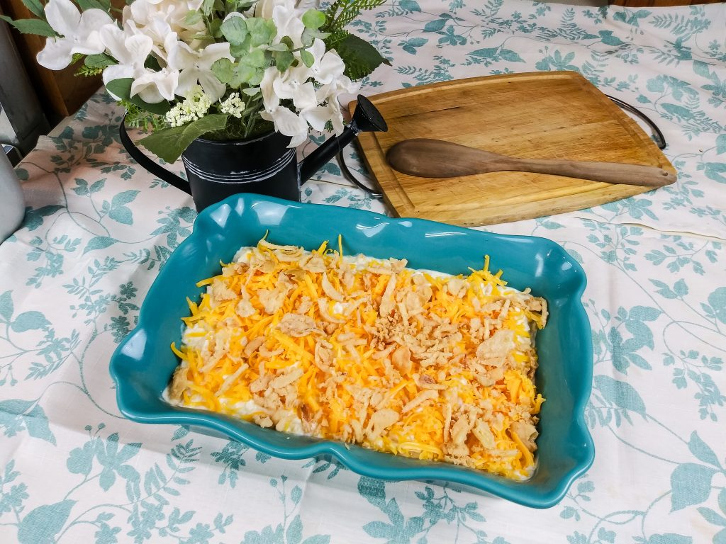 cheesy french onion chicken casserole in blue pan on counter top