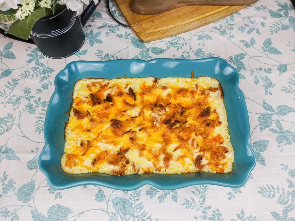 casserole cooked and sitting on blue and white table cloth